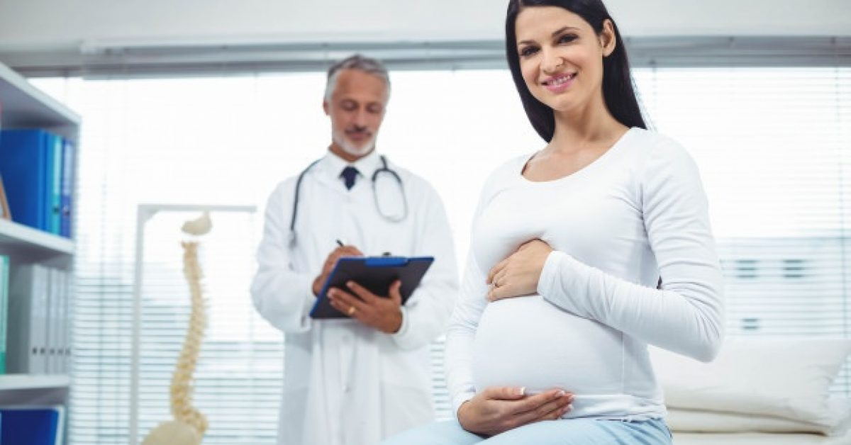 pregnant-woman-with-doctor-clinic_107420-8383
